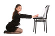 Girl in black suit sits on floor and works with notebook on stoo