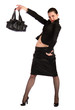Girl in black suit holds bag.