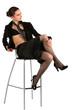 Girl in black suit posing on stool.
