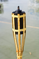 Bamboo torche near water