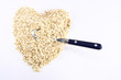 Heart shaped oatmeal with spoon