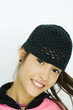 Teen girl wearing knit hat, portrait