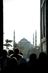 People silhouettes and the Blue Mosque
