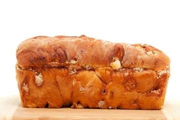 baked sugar bread in closeup on cutting board