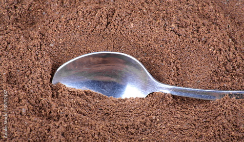 milled coffee  and teaspoon