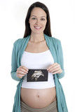 Pregnant woman holding ultrasound scan poster
