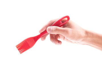Hand Holding a Cooking Sauce Brush