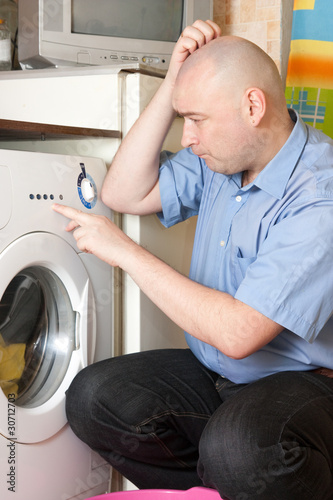 man doing laundry at his home