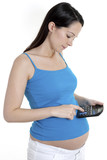 Pregnant woman using calculator