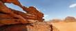 rock bridge and panoramic view of Wadi Rum desert, Jordan