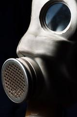 Dark gasmask on enlighted background
