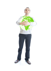 Young man holding green planet earth