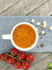 Tomato soup with fresh ingredients in a soup cup