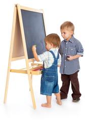 Boys are drawing on a blackboard