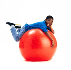 Young Boy Laying On Large Red Ball