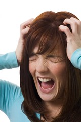 Woman Holding Head In Anguish