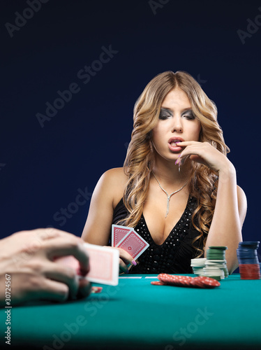 Woman doubt in a card gambling match