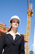 Woman on job site with crane in background