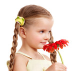 Child giving flower.