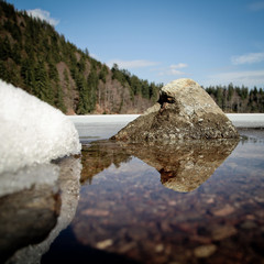 rock in lake in black forest