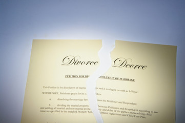 divorce decree document ripped in two