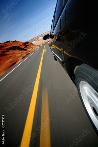 Car driving on rural road - mounted camera natural motion blur
