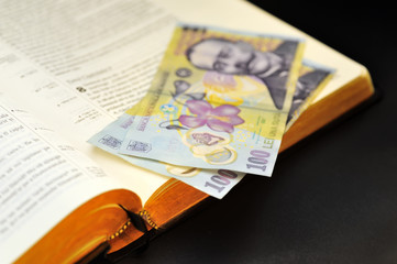 offering  romanian currency and holy bible