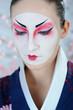 japan geisha woman with creative make-up.close-up artistic portr