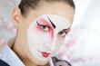 close-up artistic portrait of japan geisha woman with creative m