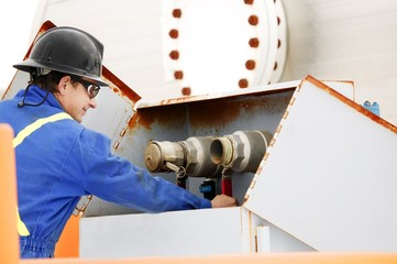 Man Working On Oilfield Machinery