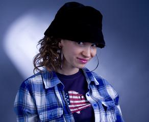 Sly girl in black hat.