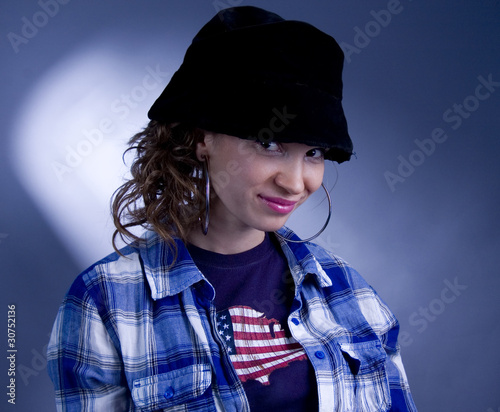 Sly girl in black hat.