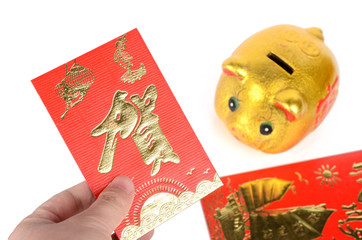 Piggy bank and red packet