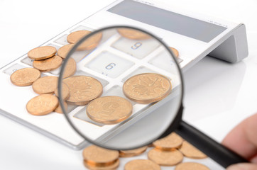 Calculator and magnifier with coins