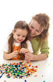 Woman and little girl playing with beads and a string