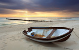 Fototapety Boat on beautiful beach in sunrise