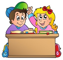 Two children at school desk