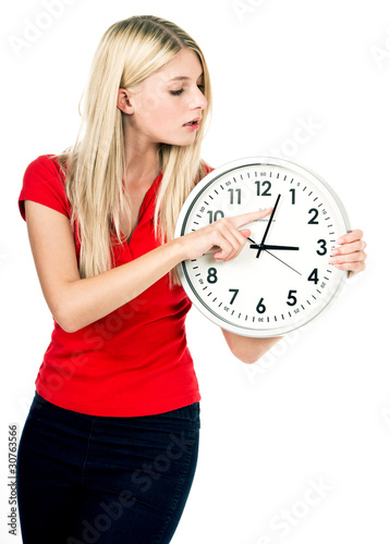 Young beautiful woman with the clock