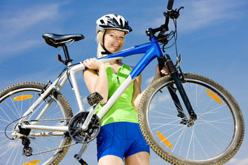 biker carrying her bicycle