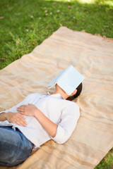 Woman sleeping with her book