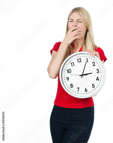 tired young woman with the clock