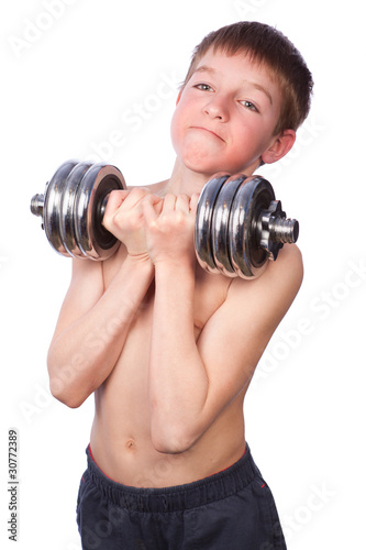 Tennager lifts heavy dumbbell