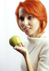 The beautiful woman with an apple in a hand