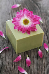 Bar of natural green soap with flower