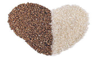 heart shape dry buckwheet and rice isolated over white