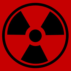 Radiation round sign on red background