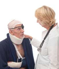 Doctor tending old man with multiple injuries