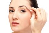 woman plucking eyebrow tweezers poster
