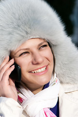 Portrait happy women talking by a cellular telephone