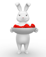 Easter bunny holding a bowl of red eggs